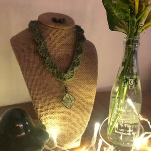 green crochet necklace with crystal pendant